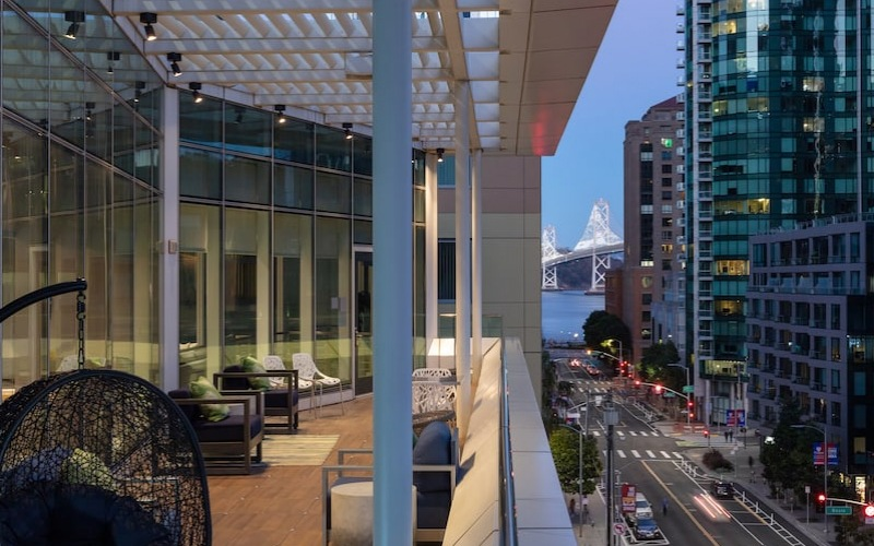 outdoor 7th floor terrace seating and views of the city