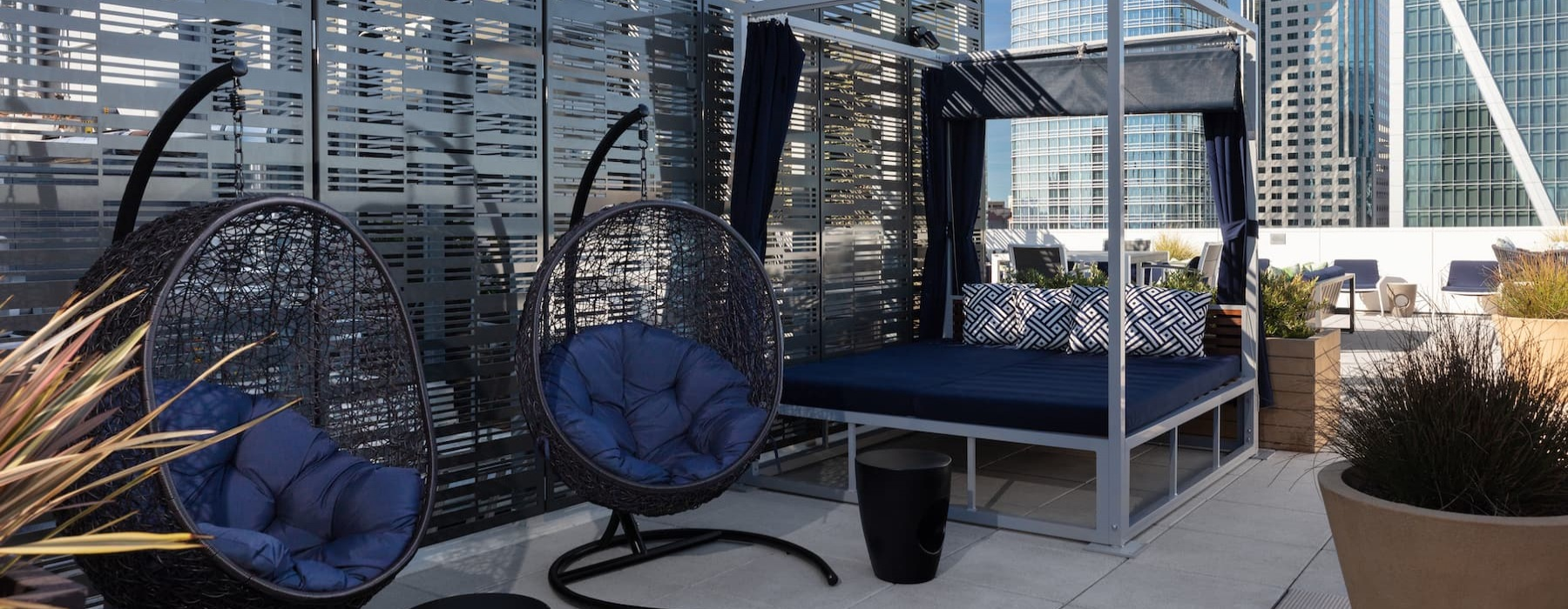 spacious rooftop lounge area with views of the city skyline and modern decor