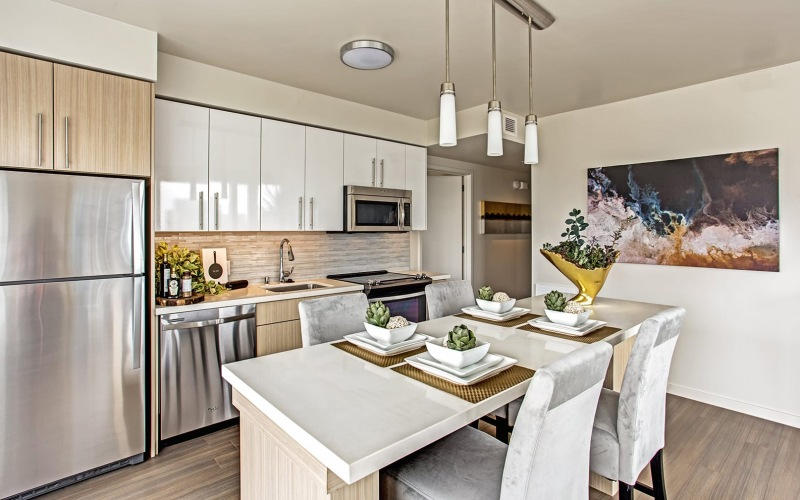 kitchen with an island, bar area, and ample counter-space
